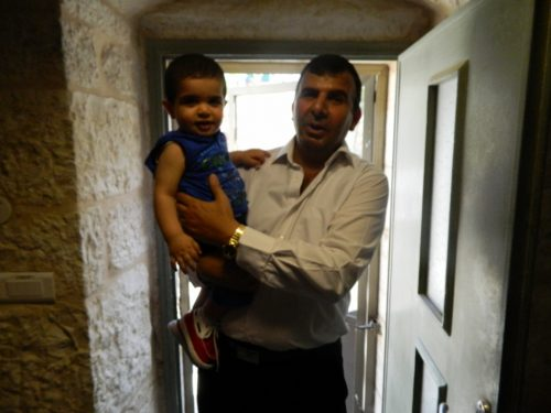 Our staff member Adnan with his toddler